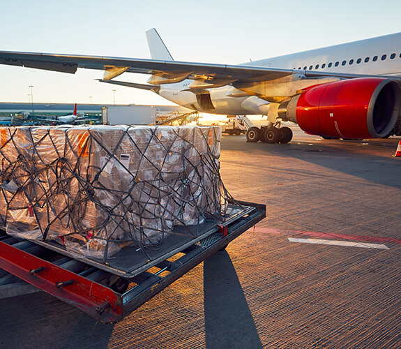 Reduce Freight Costs scene showing plane and freight on a pallet
